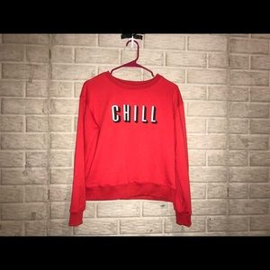 Tops - A red pull-over sweatshirt
